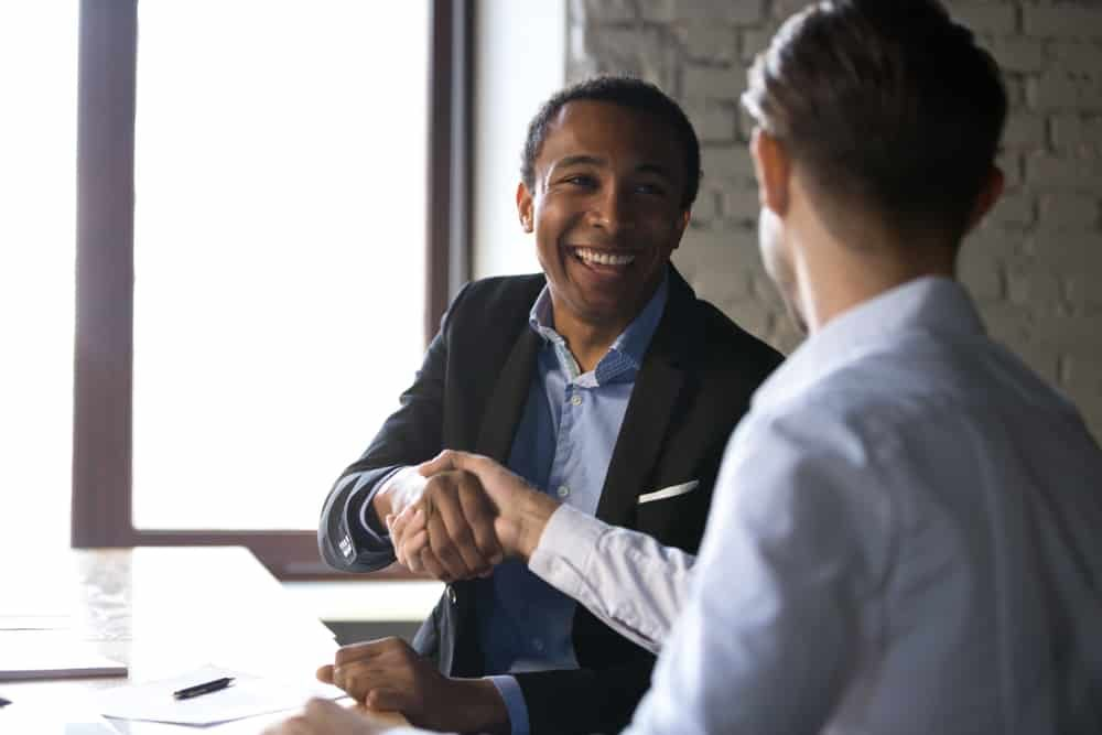 Happy,Satisfied,Black,Client,Shaking,Hands,Thanking,Manager,For,Good